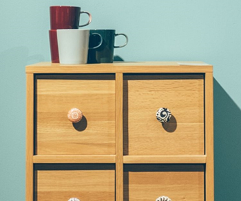 dresser with coffee cups
